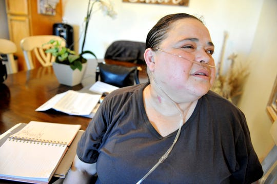 On June 10, 2019, Veronica Castro shows the scar on her neck from ECMO treatment. which saved her life.