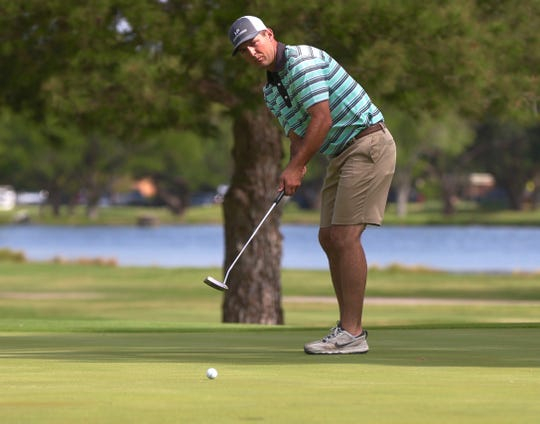 Word Hudson watches as his ball nears the cup during the opening round of the San Angelo Country Club Men's Partnership on Thursday, June 27, 2019.