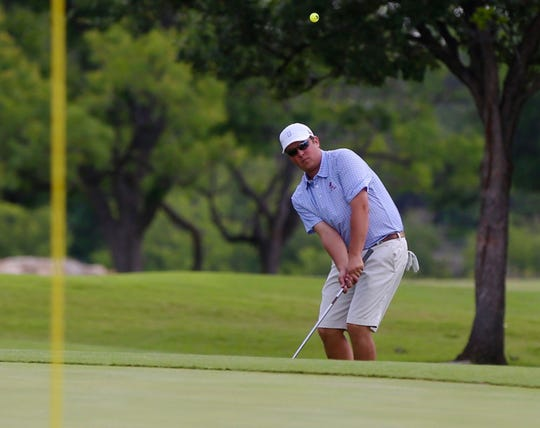 John Hudson chips onto the green during the first round of the 2019 San Angelo Country Club Men's Partnership on Thursday, June 27, 2019.