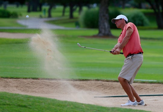 Colton Williams gets out of a sand trap during the opening round of the 2019 San Angelo Country Club Men's Partnership on Thursday, June 27, 2019.