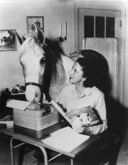 "A photo of ""Misty of Chincoteague"" author Marguerite Henry and Misty"