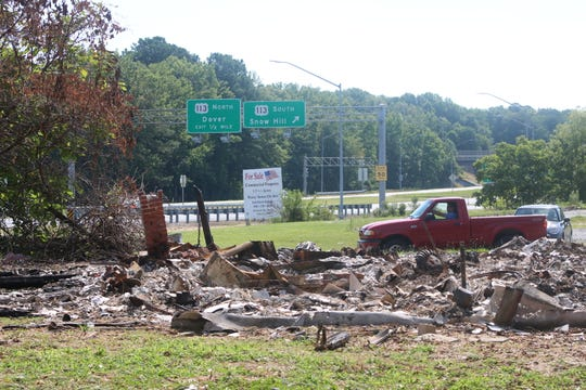 The foundation of a burnt down home sits at the edge of a piece of land that may be turned into a 7-Eleven on June 26, 2019. The piece of land sits at the corner of Route 50 and Main Street in Berlin.