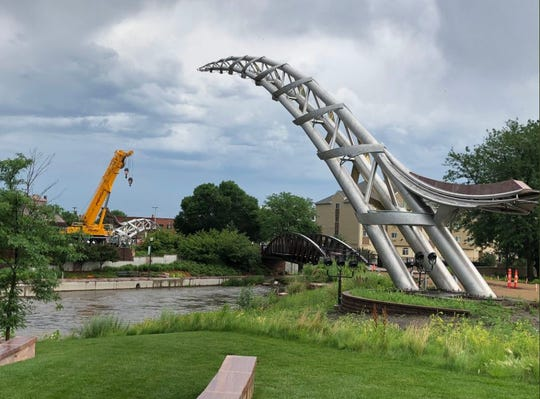 The second piece of the Arc of Dreams is being installed Thursday morning in Sioux Falls.