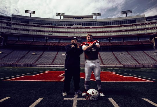Chamberlain senior Nash Hutmacher poses for a photo with Nebraska defensive line coach Tony Tuioti at Memorial Stadium in Lincoln, Neb. Hutmacher verbally committed to the Cornhuskers on Saturday.