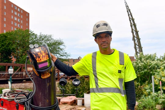 Luis Diaz, welder for Tull Companies, stands with his welding equipment at the site of the Arc of Dreams on Thursday, June 27, in Sioux Falls.