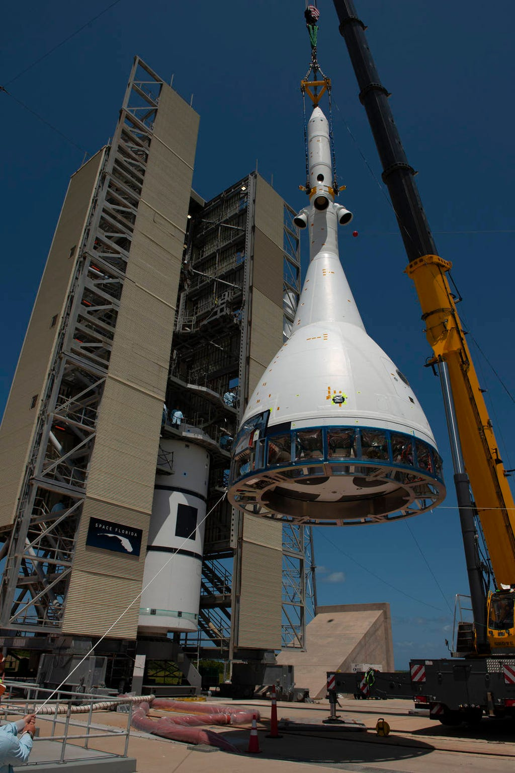 The test version of Orion attached to the Launch Abort System for the Ascent Abort-2 (AA-2) flight test is hoisted up by crane at Space Launch Complex 46 at Cape Canaveral Air Force Station in Florida on May 23, 2019. The flight test article will be moved inside the vertical integration facility for stacking atop the booster. The booster was procured by the U.S. Air Force and manufactured by Northrop Grumman. During AA-2, targeted for July 2, the LAS with Orion will launch on the booster more than six miles in altitude, where Orion's launch abort system will pull the capsule and its crew away to safety if an emergency occurs during ascent on the Space Launch System rocket. AA-2 is a critical safety test that helps pave the way for Artemis missions near the Moon, and will enable astronauts to set foot on the lunar surface by 2024.