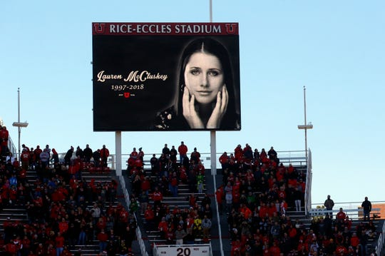 In this Nov. 10, 2018, file photo, a photograph of University of Utah student and track athlete Lauren McCluskey, who was fatally shot on campus, is projected on the video board before the start of an NCAA college football game between Oregon and Utah in Salt Lake City. The family of a University of Lauren McCluskey sued the institution on Thursday, June 27, 2019, saying officials have refused to take responsibility for missing chances to prevent her death despite multiple reports to police.