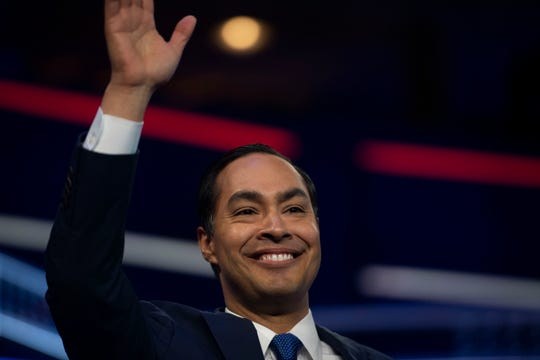 Democratic presidential primary candidate Sen. Julián Castro enters the debate stage Wednesday, June 26, 2019, at the Adrienne Arsht Center for the Performing Arts in Miami.