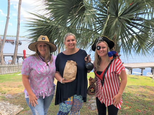"Tammy Calabria, left, Tara Biek and Katie Makemson take a break from capturing the castaways for ""Shipwrecked."""