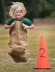 Lauren Good, 6, competes in a sack race during the field day held at Rosewood Magnet School on May 10, 2006.