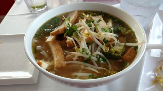 Pho chicken noodle soup at Miss Saigon,comforting broth simmered with onions, ginger, spices, soy sauce and fish sauce with thin-sliced chicken breast and noodles, was delicious.