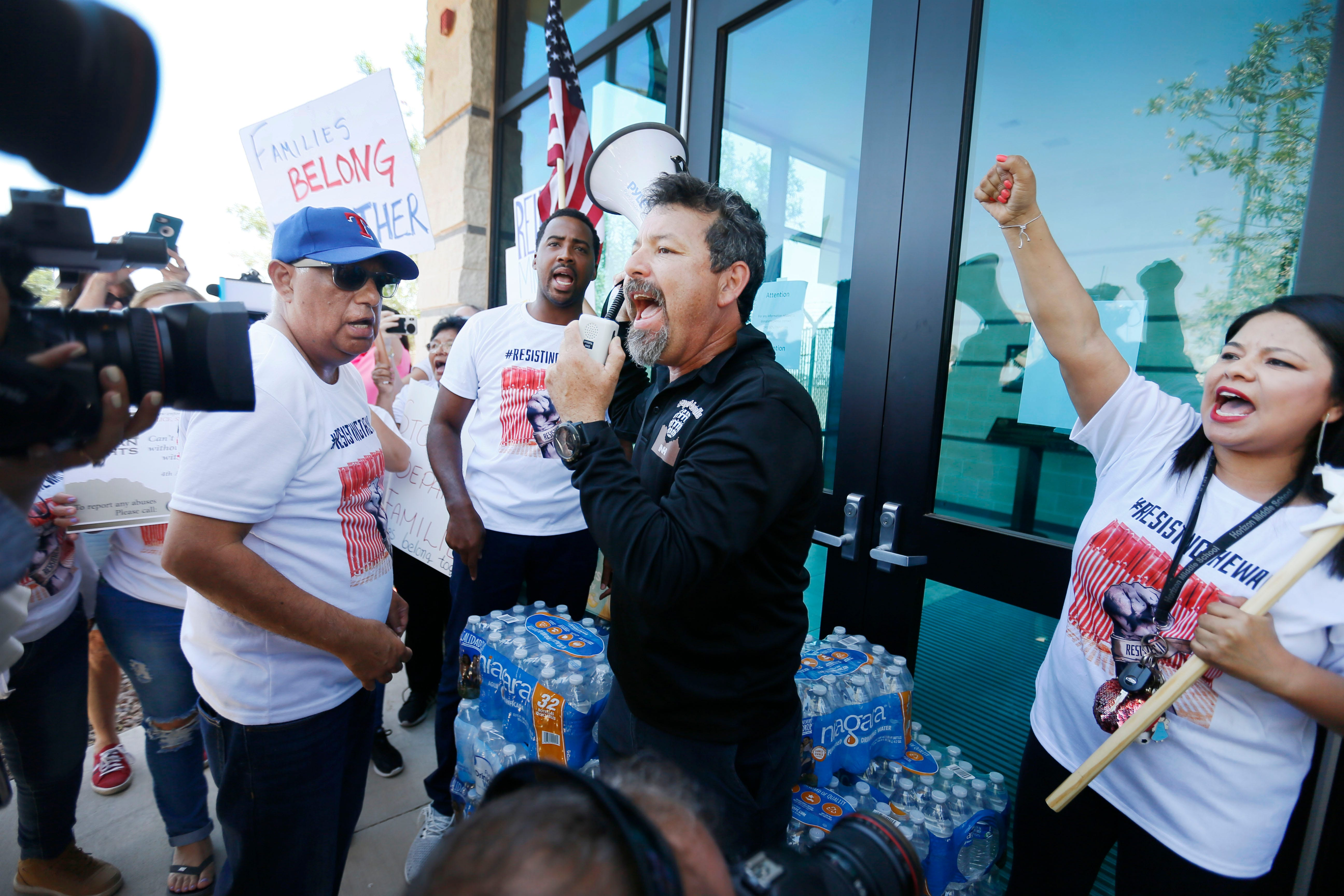 Fernando Garcia, BNHR executive director, says some words of encouragement to the protesters at the doors of the Border Patrol station in Clint, Texas, Thursday, June 27. The protesters gathered at the doors in opposition of the alleged mistreatment of the migrant children at the station. The Border Network for Human Rights organized the protest. A group from California, CaravanToClint, also joined BNHR outside of the station.