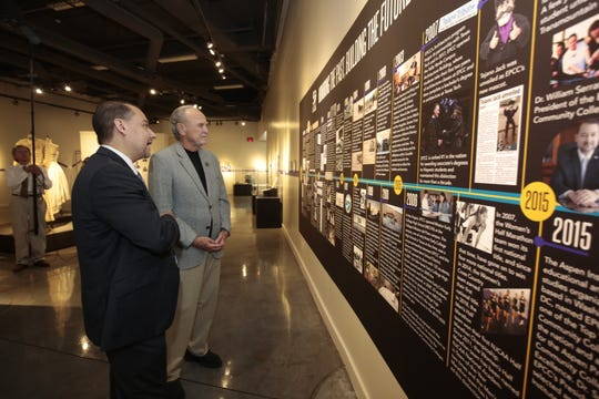 Former state Sen. Joe Christie, left, and EPCC President William Serrata tour the El Paso Museum of History Thursday, June 27.