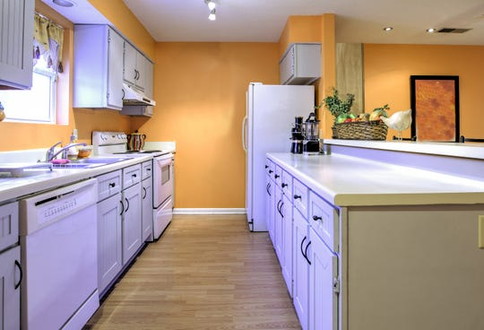The galley design provides easy access to all appliances in the kitchen without having to walk far.