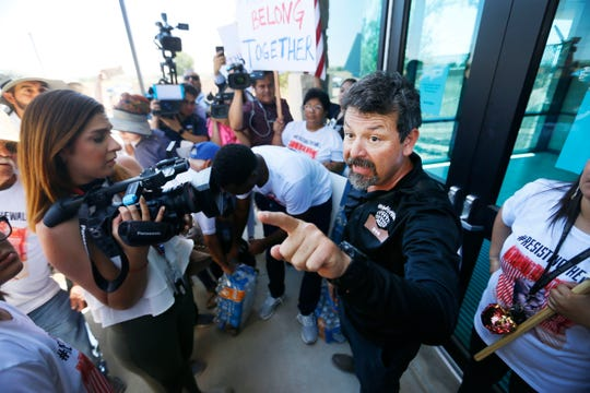 Fernando Garcia, BNHR executive director, talks to a We Build the Wall supporter who was questioning his actions at the doors of the Border Patrol station in Clint, Texas, in opposition of the alleged mistreatment of the migrant children at the station Thursday, June 27. The Border Network for Human Rights organized the protest. A group from California, CaravanToClint, also joined BNHR outside of the station.