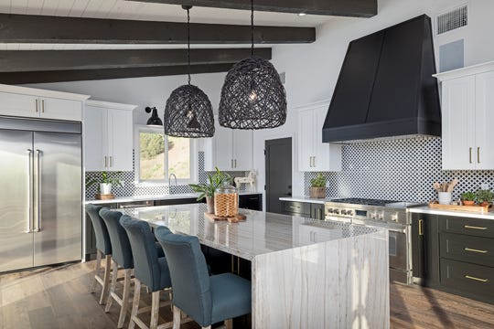 Planning is essential when designing the perfect kitchen. Experts suggest starting with the initial layout.