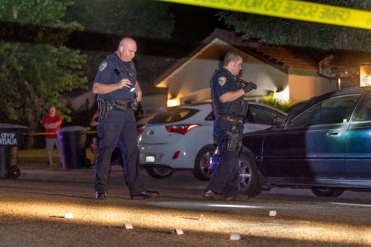 Visalia Police investigate a shooting in the 4200 block of East Laurel Avenue on Wednesday, June 26, 2019. Police responded to the area about 10:30 p.m. for a report of gun shots and discovered the victim upon their arrival. Neighbors reported hearing about six shots. An adult male was transported to KDMC in critical condition with multiple gunshot wounds.
