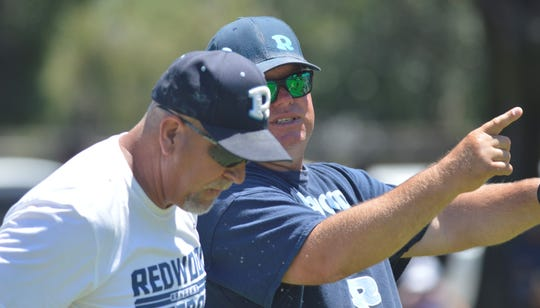 Kevin Scharton is in his first season as the Redwood High School head coach.