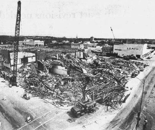 The demolition of an eight-block area in downtown Wausau in preparation for the future Wausau Center mall continues in this June 13, 1981, file photo. A significant number of buildings had already been knocked down. This photograph was taken from the roof of the Johnson Hill's store at 300 Third Street. (Wausau Daily Herald photo)