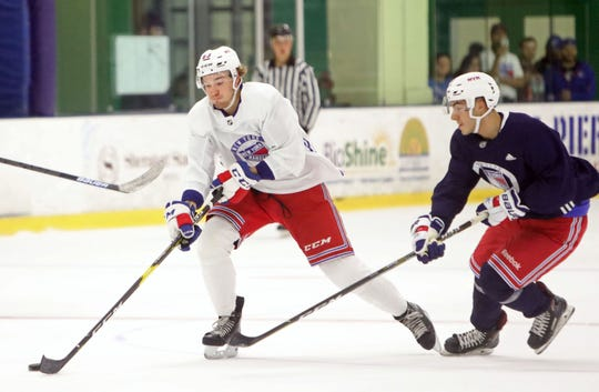 Eric Ciccolini, right, pressures Jake Elmer during the New York Rangers prospect development camp scrimmage June 27, 2019 at Chelsea Piers in Stamford, Conn.