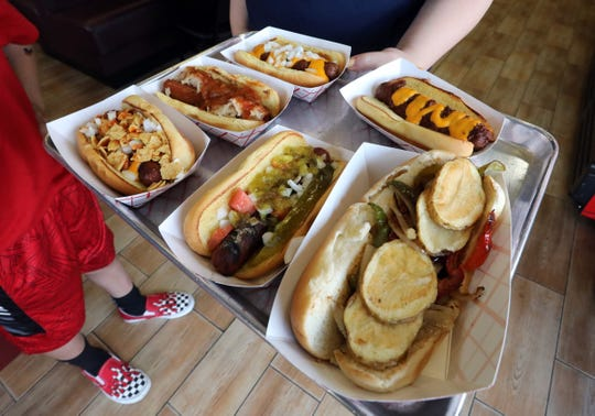 Hot dogs and a chicken sandwich at the Dawg House in Nanuet June 27, 2019.