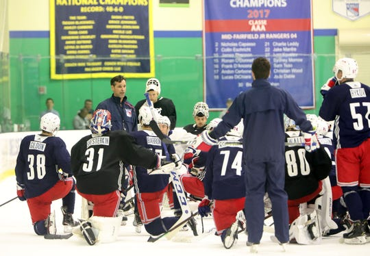 New York Rangers coach David Quinn meets with the team after the prospect development camp scrimmage June 27, 2019 at Chelsea Piers in Stamford, Conn.