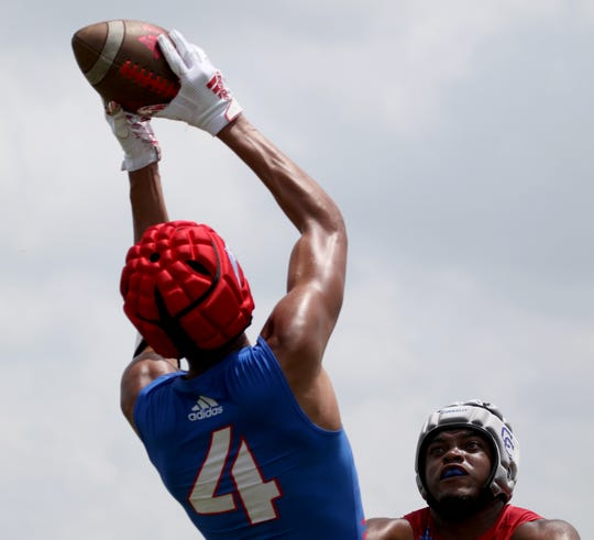 Hirschi's Isaiah Wilson makes the catch for a touchdown in the Texas State 7on7 tournament against Connally Thursday, June 27, 2019, at the Veterans Park and Athletic Complex in College Station.