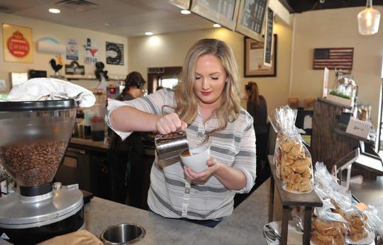 Frank & Joe's Coffee House co-founder, Jessica Edwards make a latte at their Parker Square location on Kemp Boulevard. Frank & Joe's expanded to a second location on 9th Street near the hospital.
