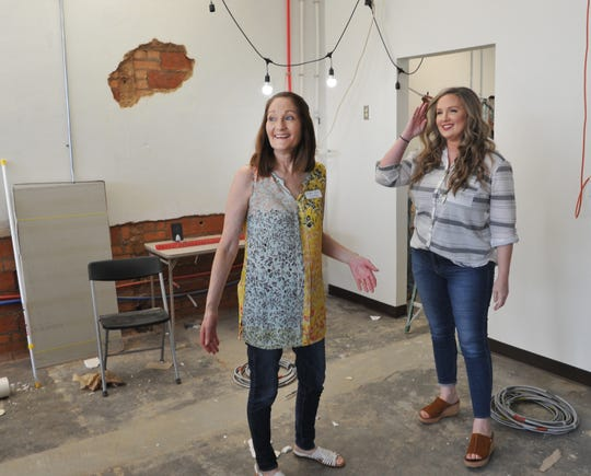Frank & Joe's Coffee House founder, Carol Murray, left, and co-founder, Jessica Edwards look at the construction progress of their second location near the hospital on 9th St.