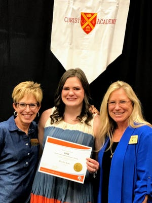 The prestigious P.E.O. STAR Scholarship for the 2019-2020 academic years was presented to Grace Minter, center, a senior at Christ Academy.The scholarship was presented by Staci Shanes,left, and Sheila Meador, members of P.E.O.  Chapter EA, Wichita Falls.