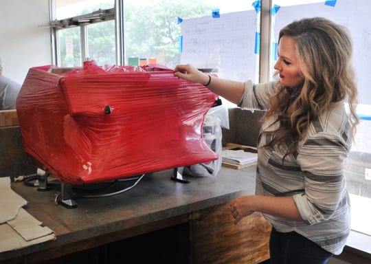 Frank & Joe's Coffee House co-founder, Jessica Edwards unboxes equipment that will be used at their second location near the hospital on 9th St.