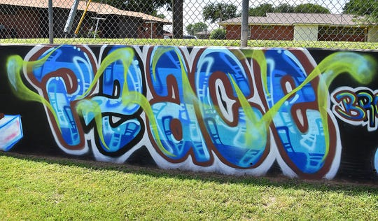 Peace, love, respect and unity are four of the main elements in a mural designed by Jacobie Genus to promote positivity. The mural covers a 445-foot retaining wall at the Wichita Falls Housing Authority park off Harding Street.