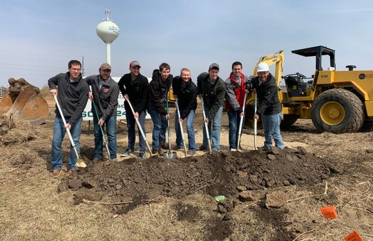 The Madison employees at MacDon, an agricultural equipment manufacturer, helped break ground at a new facility in Sun Prairie Business Park. Pictured (from left) are (* identifies UW-Madison alumnus) *Scott Dietsche, *Chase Walters, *Nicholas Friberg, Austin Bossaer, *Dan Flick, Karl Hundt, *Nolan Lacy, *Neil Barnett. Brian Straub and Cyrus Nigon, not shown, also have degrees from UW-Madison.