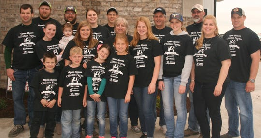 Decked out in their special shirts, the Clinton Clan was on hand to welcome 800 visitors who came to their recent open house.