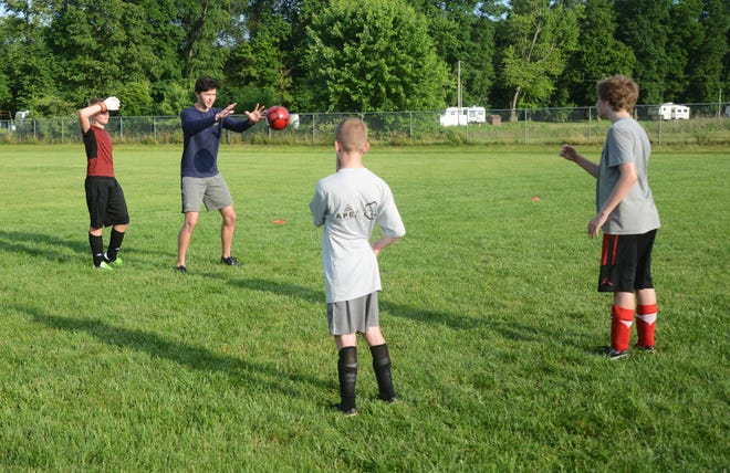 Keagan McLaughlin, a Rosecrans graduate playing soccer for Notre Dame, works with kids during Tri-Valley's soccer camp on Wednesday. McLaughlin is spending the summer playing for the Cincinnati Dutch Lions, a pre-professional soccer team.