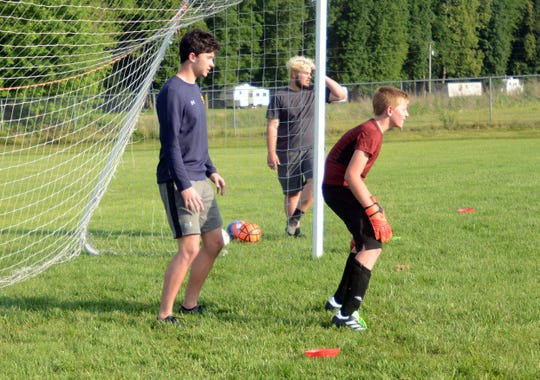 Keagan McLaughlin, a Rosecrans graduate playing soccer for Notre Dame, works Micah Shupert during Tri-Valley's soccer camp on Wednesday. McLaughlin is spending the summer playing keeper for the Cincinnati Dutch Lions, a pre-professional soccer team.