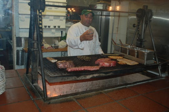 The cooking style at the Hitching Post II is Santa Maria BBQ, where meat is dry-seasoned and cooked over a live fire of California red oak while being frequently basted.