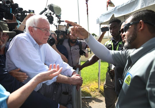 Sen. Bernie Sanders speaks to security personnel at the detention center for migrant children on June 27, 2019 in Homestead, Florida. Democratic presidential candidates visited the detention center, which is the nation's largest center for detaining immigrant children, as the candidates spend time in the Miami area as they participate in the first presidential debates of the 2020 election.
