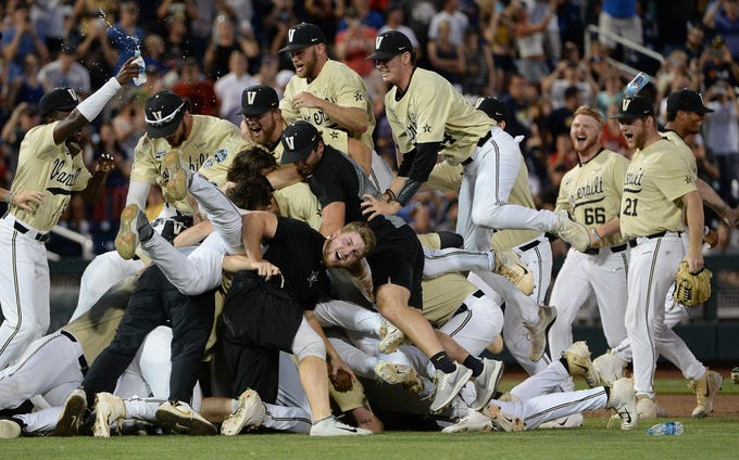June 26: Vanderbilt players celebrate after defeating Michigan 8-2 in Game 3 of the championship series of the College World Series. It was Vanderbilt's second national baseball title in six seasons.