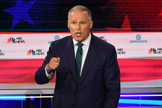 Governor of Washington Jay Inslee speaks during the first Democratic primary debate in Miami on June 26, 2019.
