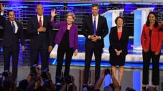 (L-R) US Representative for Ohio's 13th congressional district Tim Ryan, former US Secretary of Housing and Urban Development Julian Castro, US Senator from New Jersey Cory Booker, US Senator from Massachusetts Elizabeth Warren, former US Representative for Texas' 16th congressional district Beto O'Rourke, US Senator from Minnesota Amy Klobuchar, US Representative for Hawaii's 2nd congressional district Tulsi Gabbard participate in the NBC News Democratic Candidates debate at the Adrienne Arsht Center for the Performing Arts in Miami, Florida, on June 26, 2019. (Photo by JIM WATSON / AFP)JIM WATSON/AFP/Getty Images ORIG FILE ID: AFP_1HV8Y2