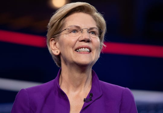 Sen. Elizabeth Warren, D-Mass., arrives to participate in the first Democratic primary debate in Miami on June 26, 2019.