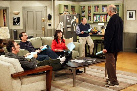 """Seinfeld"" executive producer Larry David, standing right, talks to cast members Michael Richards, left, Jerry Seinfeld, Julia Louis-Dreyfus and Jason Alexander."