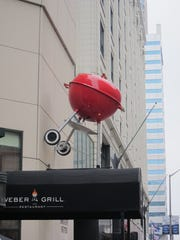 The Weber Grill restaurant is instantly recognizable thanks to the use of Weber's most iconic grill on the sign. This is the downtown Indianapolis location.