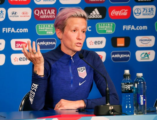 "Megan Rapinoe, answering questions before Friday's match vs. France, says of  President' Trump's tweets about her: ""I stand by the comments I made about not wanting to go to the White House – with the exception of the expletive, my mom will be very upset about that."""
