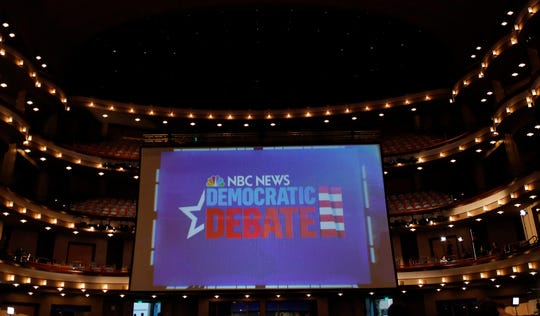 A large screen is displayed inside the media room at the Democratic primary debate hosted by NBC News at the Adrienne Arsht Center for the Performing Art, Wednesday, June 26, 2019, in Miami. (AP Photo/Brynn Anderson) ORG XMIT: OTK