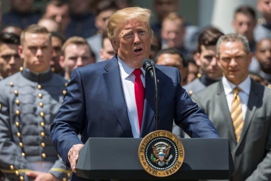 President Donald Trump speaks during the ceremony to present the Commander in Chief's Trophy at a White House event with the Army Black Knights in the Rose Garden.