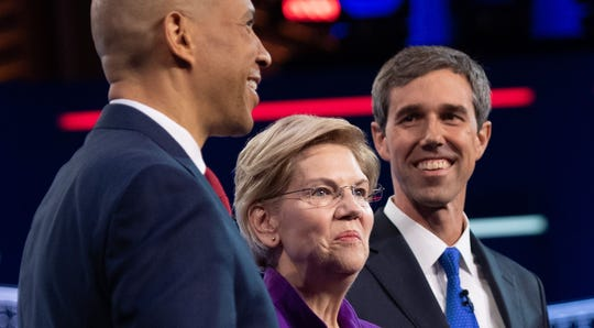 Democratic presidential hopefuls Sen. Cory Booker, Sen. Elizabeth Warren, former Rep. Beto O'Rourke arrive to participate in the first Democratic primary debate of the 2020 presidential campaign season.