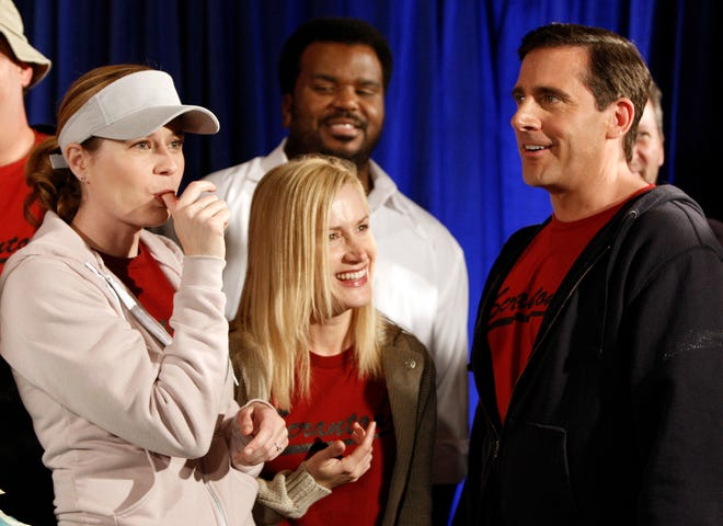 "In this April 14, 2009, file photo cast members, from left, Jenna Fischer, Angela Kinsey, Craig Robinson, and Steve Carell are seen after cutting a cake celebrating the 100th episode of the television show ""The Office"" in Malibu, Calif."