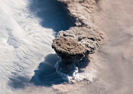 This handout image obtained courtesy of the NASA Earth Observatory taken on June 22, 2019, shows Raikoke volcano erupting in the Kuril Islands in Russia's Sakhalin Oblast region, near the Kamchatka Peninsula.